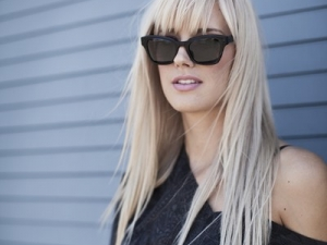 Morgan wearing Joe's Black Sunglass friezeframes